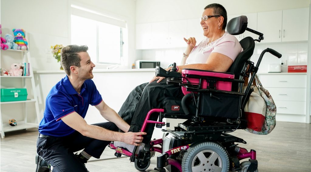 Therapist helps client in wheelchair